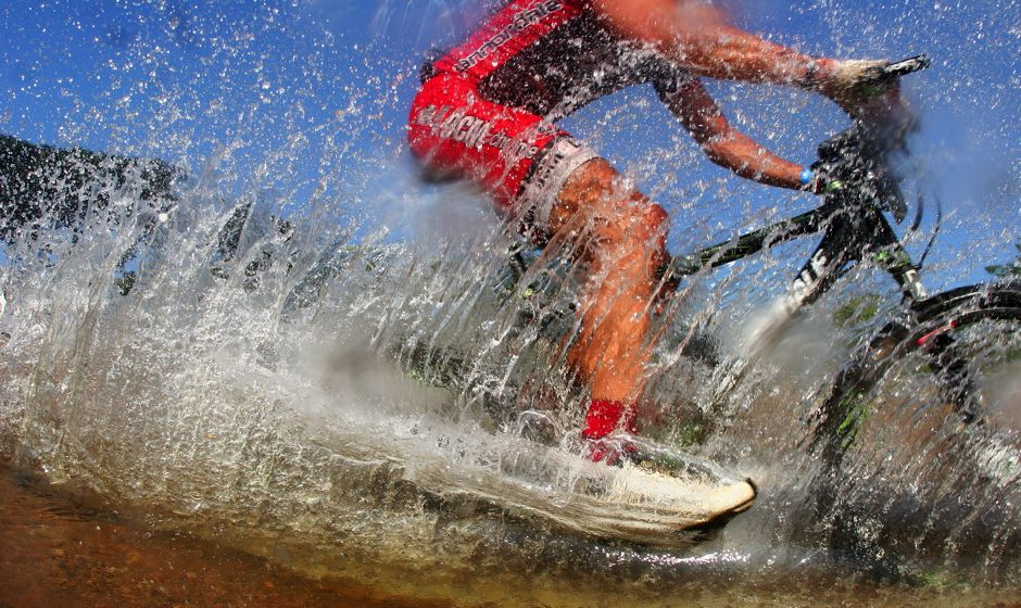 bike cyling in water splash
